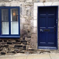 When a lovely blue door had 9 1/2 scrawled on its side.   21 Times Old Quebec City Was Too Beautifully Quaint For Its Own Good