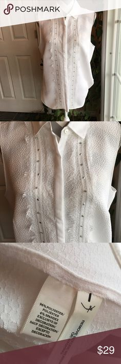 Ann Taylor white sleeveless blouse Never worn, but removed tag.  Wear it under a jacket or cardigan or alone.  Stunning!  Ann Taylor Tops Blouses