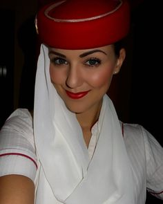 "To the lovely and efficient Emirates stewardess. ""Very well,"" she replies crisply. ""Come with me."""