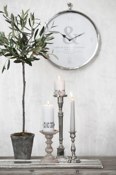 FLORA decoration olive tree, CLOTILDE wall clock, DARLA, CAVENDISH and MISTY candlesticks. Lene Bjerre, spring 2014.
