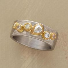 GATHERING OF DIAMONDS RING--Brilliant cuts of diamonds in vary colors gather on brushed 18kt white gold, the gems set in satiny 18kt yellow gold. 1.1 approximate total carat weight. Handcrafted in USA by Annie Fensterstock. Whole sizes 5 to 9.