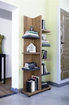 Bookcase Falster, made of Kikar Wood. It is a real eye-catcher for your living room