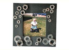 fun DIY frame. MADE: just made this for my dad's birthday. Turned out so cute! Used washers and bolts we had laying around, and a mini wrench we found at the bottom of the toolbag. Inside the frame is a pic of my dad and son using a saw together:)