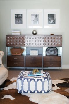 Some handbags are worth more than decor, so why hide them? We love how Jacey Duprie from Damsel in Dior used her home's console table to hold her favorite handbags. They match perfectly with her living room and can easily be swapped out for a fresh look.  Photo by  Cambria Grace Photography  via Style Me Pretty