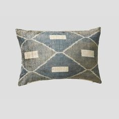Finished with a high quality feather insert and backed with natural linen. Contains a hidden zipper closure. You'll love this because... Opulent silk velvet, handwoven cushion featuring a distinct pattern in gray, steel and cream.