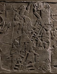 Warriors scaling walls with ladders fighting hand-to-hand. Ashurnazirpals aussault on a city. Stone bas-relief (9th BCE) from the palace of Ashurnazirpal II in Nimrud, Mesopotamia (Iraq).