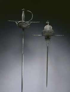 Cup-Hilted Rapier, c. 1650. Spain, Toledo. Pierced and chiseled steel;, Overall - l:122.88 cm (l:48 3/8 inches) Quillions - w:26.67 cm (w:10 1/2 inches). Gift of Mr. and Mrs. John L. Severance. -The Cleveland Museum of Art-