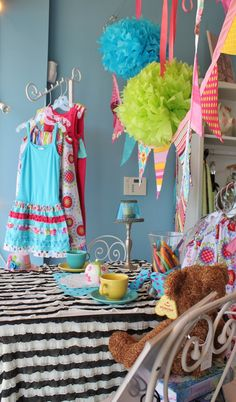 spring display | Spring window display at puddle ducks Colorful bunting & bright ...