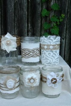 Burlap & Lace Mason Jars Shipping Included by TheBreadBarn on EtsyJars and a bit of burlap & laceImagine these lovely jars glimmering with the flicker of candlelight at your outdoor wedding.or filled with sunflowers at your rusticfabric jar wraps art Burlap Projects, Burlap Crafts, Diy And Crafts, Arts And Crafts, Mason Jar Projects, Mason Jar Crafts, Bottles And Jars, Glass Jars, Lace Mason Jars