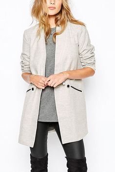 This is an fashion outwear you must have. The coat comes in light gray and features side pockets, double-breasted design. It's designed to keep you warm on these chilly days. Matching a skinny pants or throw it on with ripped jeans and ankle boots are both great.