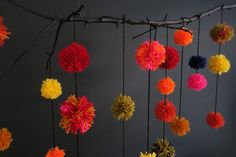 twig and pom pom wall hanging
