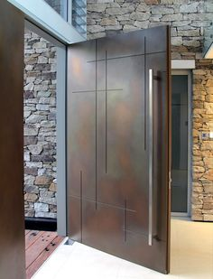 Entry Door | Axolotl Treasury Bronze Lunar Pearl metal coating applied to door with custom routed design