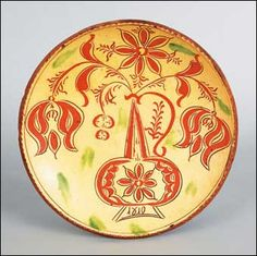 """REDWARE CHARGER, Haycock Township, Pennsylvania sgraffito decorated redware charger dated 1810, attributed to Conrad Mumbouer, with tulips and leaves emanating from an urn, all on a yellow glaze background with green splotches, 12"""""""
