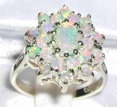 Google Image Result for http://www.thegemlovers.com/images/w2176_4_opal_white_gold_ring.jpg
