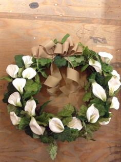 Big white Lilly with grapevine and burlap bow wreath