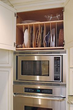 We had this and I miss having a place to store cookie sheets, muffin pans and other items.