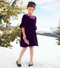 purple winter roses velvet dress - velvet and the holidays go together like Clara and her nutcracker. this beautiful style features silk flowers at the neckline and lantern sleeves.
