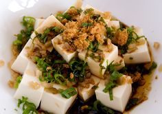 chinese cold tofu salad  -  8 oz. silken tofu, diced into 1 inch cubes 2 stalks green onions, minced 2 tbsps preserved mustard green, minced 2 tbsps pork sung 1 tsp sesame oil 1-2 tbsps soy sauce 1 thousand year duck egg (optional)