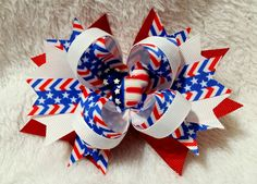 5 Inch Boutique Hair Bow Spiked Pinwheel Patriotic Resin Embellishment. Stars and Stripes, Red, White and Blue Grosgrain Ribbon This Fourth of July, patriotic, stacked hair bow is a great mid-sized ha