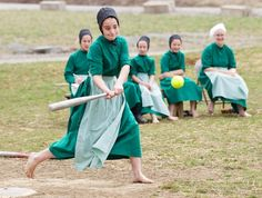 Amish girls play softball after class during an end of the school year celebration on Tuesday, April 9, 2013 in Bergholz, Ohio. The celebration was also part of a farewell picnic for those sentenced in the hair and beard cutting scandal earlier in the year.