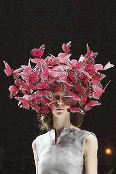 This hat created by eccentric milliner Philip Treacy and conceived by McQueen as an accessory for his 2008 runway fashion show, dramatizes the butterfly. The show and the hat were a tribute to the late Isabella Blow, who had discovered both Treacy and McQueen and championed their clothes.