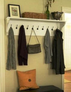 DIY Shelving Ideas: Adding hooks to a simple DIY shelf turns it into a great entryway drop spot for coats, purses, backpacks, etc. Entryway Shelf with Hooks Tutorial
