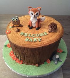 Woodland creature cake- we'd like the cake modeled after this one, but would like a deer, an owl and a bunny. possibly other animals too.