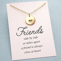 """A beautiful disc charm with a cut out heart drops below a delicate chain - sometimes it just takes a small gesture to show our love.  ✧ sterling silver or 14k gold filled chain and lobster clasp ✧ charm is either sterling silver or solid bronze, about 0.63"""" (16mm) in length ✧ choose between 16"""" to 20""""length ✧ comes in a beautiful gift box ✧ if you prefer a different card, please leave a note during check out  WAYS TO PERSONALIZE ✧ make it longer http://etsy.me/1Ga3B6H ✧ add a b..."""