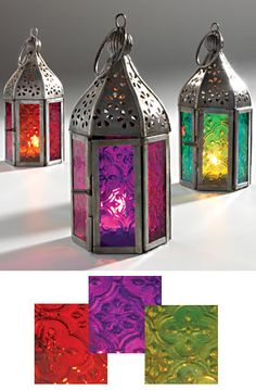 i have always loved these glass lanterns... really need to get some. they would be beautiful in a summer house
