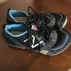 New Balance Minimus running shoes Like new women's size 9 black and blue New Balance Minimus running shoe with Vibram soles. Only worn inside a couple times at the gym so they are brand new! New Balance Shoes Sneakers