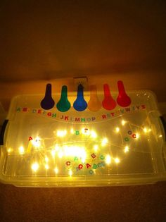 Homemade Light Box, clear storage container and christmas lights inside! My new favorite website, Play At Home Moms...there are TONS of ideas here!