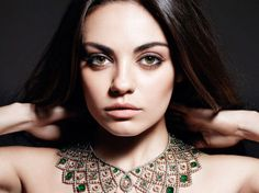 Mila Kunis as the world's sexiest woman at FHM 100 Sexiest Women poll wears an impressive emerald and diamond collar style Romanov necklace by @Faith Bergé.