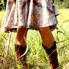 rockin cowboy boots and a dress.