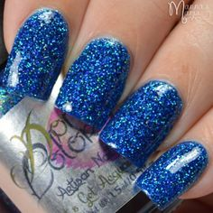 """Twinkle in The Night """"Twinkle in the night"""" is part of """"Let's Get Acquainted"""" premier Artisan Nail Glaze Collection made by Domani Color.  It is a deep blue jelly with micro turquoise holographic glitters, and a fine dust of holographic pigment sure to add a little twinkle to your night!"""