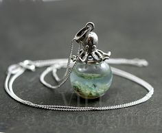 Sterling octopus seawater necklace. 925 sterling octopus carrying glass orb filled with seawater and sand. Sterling necklace. by VillaSorgenfrei on Etsy https://www.etsy.com/listing/243958250/sterling-octopus-seawater-necklace-925