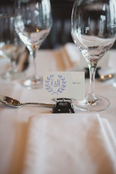 """Typed on my typewriter, stamped with a custom made stamp and displayed on a mini typewriter with the letters """" L. O. V. E"""" in white. Personalized cards for guests to find their seats :) many took their name tags and typewriters home ^_^"""