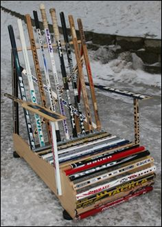 repurposed furniture - something i can do with all the hockey sticks we have (man cave upcycle hockey sticks)