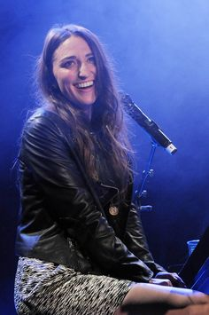 """That smile will make you come back """"1000 Times."""" Sara Bareilles beams during a performance on June 2 in London"""