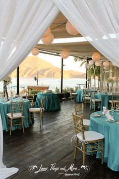 Wedding decor Teal and gold! Pefect by the ocean at Baja Cantina Cabo! With Cabo Floral Studio for the center pieces and lightening!