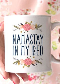 "I don't know about you, but ""namast'ay in my bed"" today. Sip your coffee in bed in this adorable mug made of a durable white ceramic. - 11oz Premium Coffee Mug - Double Sided - Dishwasher safe - Made"