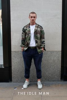 Men's street style   Camo Look - Get this guys look by rolling up a casual pair of navy chinos and holding them up with a funky belt. Add a plain white t-shirt to complement the camo worker jacket which definitely makes the statement piece for this outfit. Add some casual white running trainers to match the t-shirt and you've got yourself a winner.   Shop the look at The Idle Man