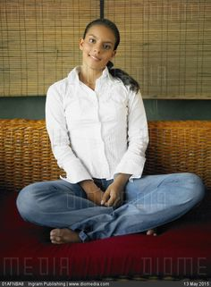Portrait of a teenage girl sitting on a couch - stock photo.Tags: barefoot, bare sole, bootcut, feet, female,flared, girl, jeans, look women, white shirt, босиком, джинсы-клёш