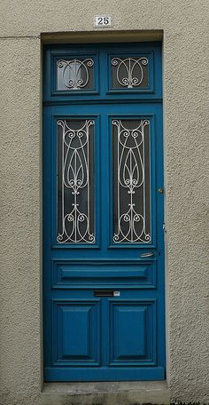 Hagetmau, France (40), porte avec grille en fer forgé. photo by Marie-Hélène Cingal, via Flickr