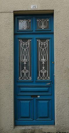 Hagetmau, France (40), porte avec grille en fer forgé. photo by Marie-Hélène Cingal, via Flickr