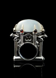 Cathedral Ring on Moonstone. William LLewellyn Griffiths designer. Metal Couture Jewelry. Melbourne. Inspired by Medieval and Gothic architecture. Note the gargoyles!