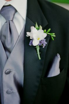 White and lavender boutonniere