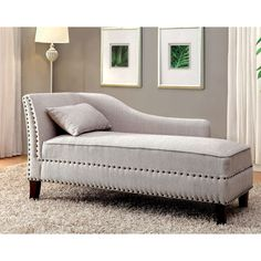 Add a relaxed vibe to any room with this subtle and romantic upholstered chaise. The curved arm doubles as a convenient backrest and the lengthy seat provides a comfortable lounge design, especially when paired with the soft fabric.