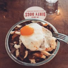 Egg on a poutine. Why not? #onlyinmontreal #mtlfood #mtlrestaurant #poutine #poutinerie #greatfood #quenchmagazine #dirtydogsmtl #dirtydogs