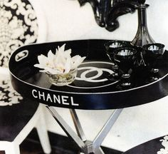 Chanel, perfect for a powder room/closet to put all of your girly hair products and lotions and perfumes