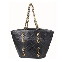 CHANEL Quilted Small Bucket Handbag | From a collection of rare vintage handbags and purses at http://www.1stdibs.com/fashion/accessories/handbags-purses/